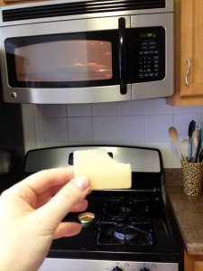 Enjoy a piece of cheese while waiting for the pizzas to heat up :)